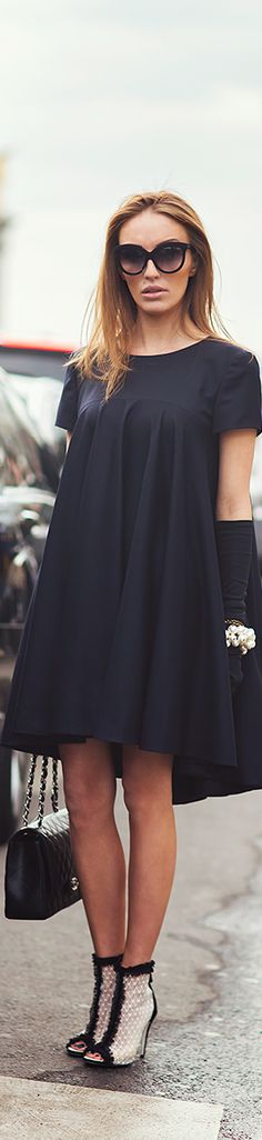 LOVE this black LBD. It's like a sophisticated babydoll dress & pairs perfectly w/ the white Chanel shoes w/ black trim + black quilted Chanel purse.