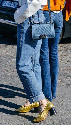 High-waisted jeans, denim quilted Chanel bag, metallic gold Celine ballerina pumps