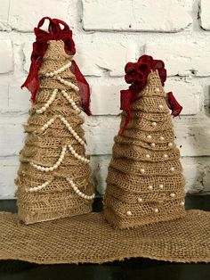 Burlap Christmas Trees. Layers of burlap surround the wooden structures on this set of rustic Christmas trees. One has a shabby, unkempt appearance, while the other is more refined. Making these handmade trees the perfect mixed, but matched pair. Acrylic pearls decorate the trees