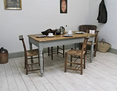 Antique painted farmhouse kitchen table.A rustic old pine kitchen table with waxed top surface and turned legs. It will easily accommodate six people. The frame and legs have been painted in Paris Grey chalk paint before being waxed for durability. Each individual piece of furniture upcycled by Distressed but not Forsaken is completely unique and a one-off.Pine.Height: 75cm Width: 151cm Depth: 82cm
