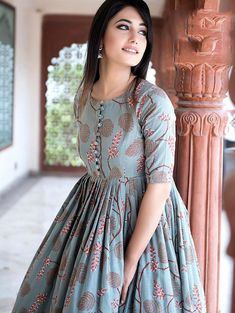 Beautiful Kurtis Online : Stylish and Trendy Kurti for Women - Light Steel Blue Muslin Printed Anarkali Long Kurti Source by sareecom_india - Simple Kurti Designs, Kurta Designs Women, Kurti Neck Designs, Kurti Designs Party Wear, Dress Neck Designs, Simple Gown Design, Latest Kurti Designs, Plain Kurti Designs, Long Dress Design