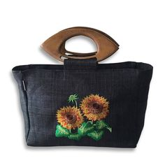 "Sunflower Leah Bag Price: ₱ 1,250  Description: - A cute and chic bag that is handy and durable for any occasion. - Beautifully embroidered with wooden handle. - Zippered. - Raw Material: Abaca material - Size: 12"" X 8"" X 3"" - Weight: 130g  #livefair #lifthumanity #philippineartisans #our7107islands #wearFilipino #lovewithacause #philippines #handmade #handicrafts #abaca #bag"