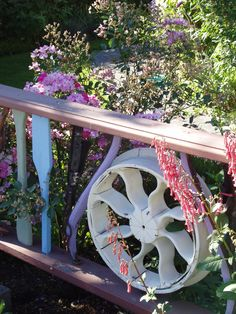 "whimsical garden fence using ""found items"""