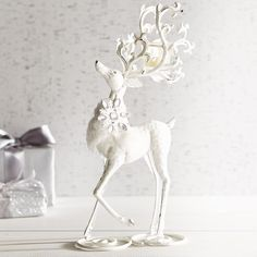 Pier 1 Imports Standing Deer Tealight Holder ($28) ❤ liked on Polyvore featuring home, home decor, white, pier 1 imports, christmas home decor, wrought iron home decor, white home decor and handmade home decor