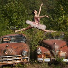 Love love love, the contrast of beauty (the dancer) and no so pretty (the cars) the whole shot is amazing