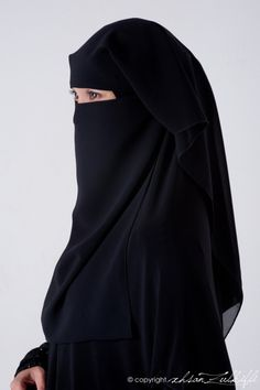 Elegant Muslim Woman in Black Niqab