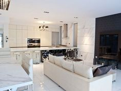 White Stylish Sofa In A Contemporary Living room Design With White Tile Floor And Mini Bar
