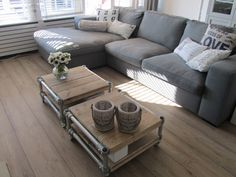 Love the industrial look of the coffee tables with the metal pipe framing.