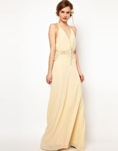Maxi dress by Jarlo \n\n-\nMade from a delicate sheer chiffon\n\n-\nEasy-care poly fabric\n\n-\nHalterneck design with a v-neckline\n\n-\nRouleaux button placket \n\n-\nCrochet lace waistband\n\n-\nFluid skirt with soft pleating \n\n-\nRegular fit\n\n\n\nABOUT JARLO\n\nJarlo was created in 2008 by Carly Hallahan and started life on a stall on London's famous Portobello road. An obsession with all things beautiful translated into a collection of covetable vintage silhouettes ranging from…