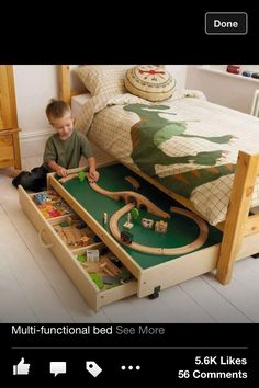 Train table underneath bed. Perfect!