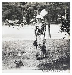"MARY LENCRET A WELL-KNOWN DEMI-MONDAINE WALKING HER GRIFFON IN PARIS C. 1906  ""Mary Lencret, a well-known Demi-mondaine who I found particularly seductive*   by J.H.Lartigue [aged 12 at the time]  Demi-Mondaine was a term used to describe a woman that was supported by a wealthy lover."