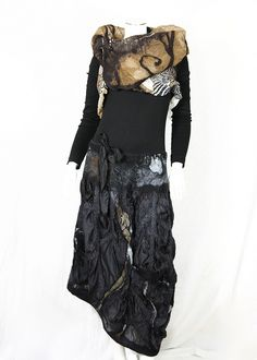 gypsy type black costume with various materials artfully combined.