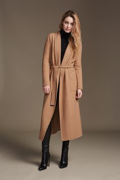 DAPHNE is a straight fit, maxi length belted coat in a signature luxurious double-face wool. A generous shawl collar cascades to the hem that creates a casual, chic silhouette. Discover at http://www.soiakyo.com/ca/en/daphne-double-face-wool-coat-with-shawl-collar-in-honey-for-women