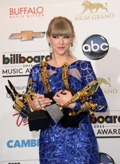 """Taylor Swift was the big winner at last night's Billboard Music Awards, sweeping the top all-genre categories and taking home eight awards. Taylor won Artist of the Year, Top Billboard 200 Artist (her second win in this category in three years), Top Female Artist, Top Digital Songs Artist, Top Billboard 200 Album (for RED), Top Country Artist, Top Country Album (for RED), and Top Country Song (for """"We Are Never Ever Getting Back Together"""")."""