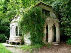 Stourhead Gothic Cottage, Wiltshire. Stourhead is a 2,650-acre estate at the source of the River Stour near Mere, Wiltshire, England. The estate includes a Palladian mansion, the village of Stourton, gardens, farmland, and woodland. Stourhead has been in the ownership of the National Trust since 1946.  Photo by Peter Wright