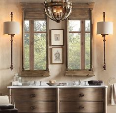 Rustic bathroom.  I like the pictures set between the 2 mirrors.  The light fixtures aren't my favorite nor the shape of the cabinetry.  I do like the palette though.