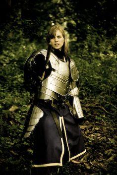 Plate Armor, female knight, blue tinic, blond hair, sword