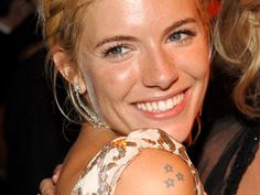 Sienna Miller has a tattoo of three five pointed stars on her right shoulder.