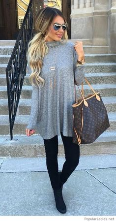 Beautiful grey dress with black leggings and boots
