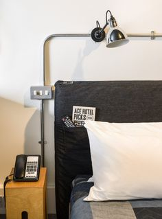 Ace Hotel Bedroom Headboard in Shoreditch, London | Remodelista--exposed conduit
