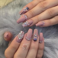 Nude matte with Swarovski crystals nail art