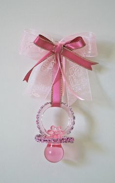 Rhinestone Pink pacifier Baby Shower Brooch. Think  I could make these. If they were small enough maybe everyone could have one.