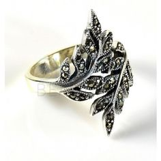 Afet Marcasite Leaf Sterling Silver Ring  - A thin polished .925 silver band wraps around to form two leaves. The leaves are outlined with lined silver and filled in with marcasite. This creates an appealing antique appearance and adds a little sparkle to the ring as well. http://simplybeautiful2012.com/rings/afet-marcasite-leaf-sterling-silver-ring.html#.Us1vwbznbIU
