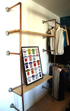Industrial copper pipe and reclaimed wood shelving unit, with open wardrobe, including storage shelves and clothing rail. Custom built