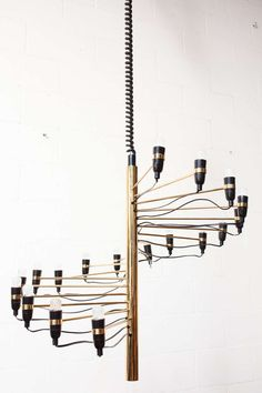 Gino Sarfatti Radiating Brass Chandelier | From a unique collection of antique and modern chandeliers and pendants  at http://www.1stdibs.com/furniture/lighting/chandeliers-pendant-lights/