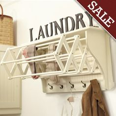 a great organized way add a drying rack to your laundry room