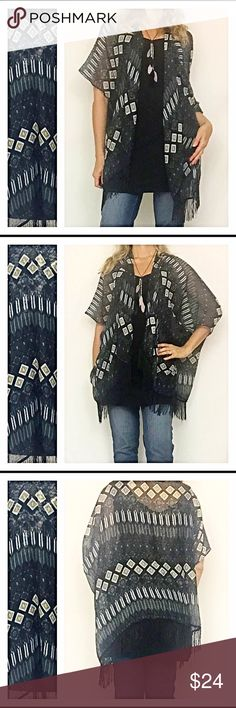 """Fringe Hem Boho Tribal Kimono Cardi One Size Wrap yourself in this lightweight semi-sheer kimono this season. You will love the tribal print in gray, white & khaki against the black background. The fringe hem is a great trendy touch. One size fits most (Sizes XS-LG) 100% Polyester. Model 5'7"""" for reference Sweaters Cardigans"""