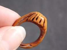 The poor mans wedding ring... But so charming that you dont mind!  This is a really neat hand carved peach pit ring. It is well made and has a
