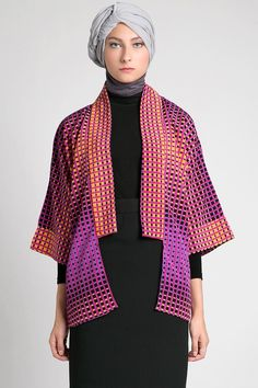 Elva Outer by AISHKA. Simple loose outerwear whit no closures, it has kimono sleeves and is perfect for casual look. With purple and orange color combination and abstract pattern, that make this kimono outer looks so unique. http://www.zocko.com/z/JFewN