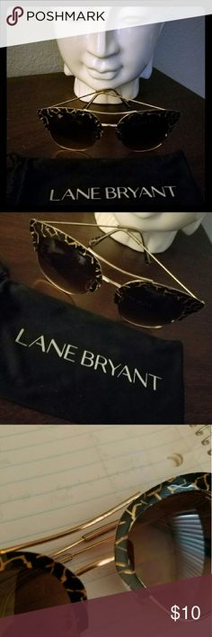 Black and Gold Sunnies Super cute black and gold sunnies with brown lenses. Slight discoloration on the front, hardly noticeable. Thanks for looking! Lane Bryant Accessories Sunglasses