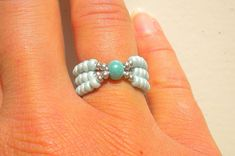 Items similar to Turquoise stretch ring - light blue mint green seed beads on Etsy