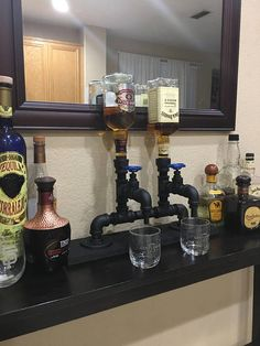 Double Liquor Dispenser. All the fittings are made of Lead free fittings, Only Stainless Steel & Brass fittings/valves used ***NO black steel (will rust) All are painted with a Flex Seal style paint -Made to order to your desired base wood finish: natural weathered gray, black or weathered