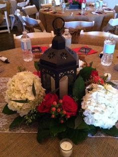 Beautiful red and white centerpiece with lantern by Fields in Bloom