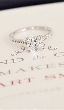 Love the modern feel of this beautiful diamond engagement ring.
