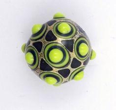 Green artisan glass lampwork focal bead di alessiafuga su Etsy