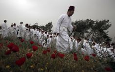 #Samaritan worshipers take part in a prayer during a Passover ceremony at Mount Gerizim near the northern West Bank city of Nablus on April 20. The Samaritan religion is based on four principles of faith, one God -- the God of Israel; one Prophet -- Moses Ben Amram; the belief in the Torah -- the first five books of the Bible; and one holy place -- Mount Gerizim.  JAAFAR ASHTIYEH/AFP/Getty Images