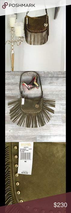 NWT Michael Kors Dakota saddle bag. STUNNING Michael Kors Dakota saddle bag in the new IT color olive green. This saddle bag has never been worn and is NWT... A total must have don't miss out! Michael Kors Bags Crossbody Bags