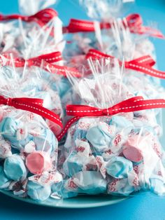 clear bags with ribbon tie. I'd add a favor tag also.
