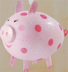 We all know people who love pig-themed items - here is a list of adorable Chirstmas ornaments that make perfect gifts for them... or yourself! 1. Olivia the Pig Glass Ornament This adorable ornament is fashioned for the children's character Olivia the Pig, but in her darling Christmas outfit and gift, she makes a perfect gift for any pig aficionado or Kurt Adler fan.