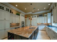 White Kitchen with dark center island - Torino at Grey Oaks, in Naples, FL