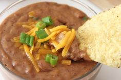 Bean Dip (1 large 29 oz can pinto beans    2 oz cream cheese    1 cup cheddar cheese    2 tsp cumin    2 tsp chili powder    2 Tbs canned diced green chilies or Jalapenos) I wonder if I could sub black beans?