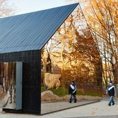 The glass facade of Mirror House Kindergarten by MLRP.
