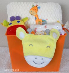 Giraffe Baby Shower Deluxe Gift Basket / Giraffe Baby Gifts / Baby Shower Gift / Baby Girl Gift / Jungle Baby Shower / Unique Baby Gift Idea by ColorfulBows on Etsy  www.colorfulbows.com #babygift #babyshower #giraffe