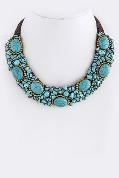 A beautiful strand of semi-precious turquoise natural stone accented with delicate gold beads make for a must-have statement piece! Finished with a dark brown crochet backing, this necklace lays comfo