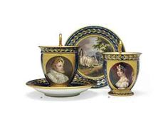 A SEVRES (HARD-PASTE) PORCELAIN BLEU NOUVEAU CHOCOLATE CUP AND TOPOGRAPHICAL SAUCER OF NAPOLEON (TASSE AU CHOCOLAT AB ET SA SOUCOUPE)  1827-1834, BLUE STENCILED CROWNED LP MONOGRAM AND SEVRES DECORATING MARKS, THE CUP WITH GREEN PAINTED GROUND COLOR DATE OF 25 JULY 1834