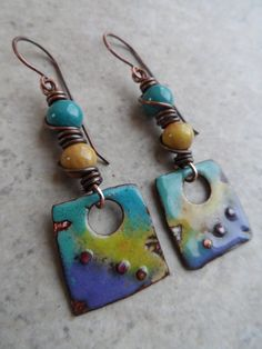 Gorgeous enameled copper charms, handcrafted by Marlene Kazor Quigley, are perfectly paired together with enameled copper beads, handcrafted by Rubi